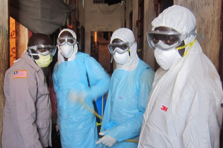 The joint fumigation team of the Ministry of Health and the Bureau of Corrections and Rehabilitation discusses the spraying operation.