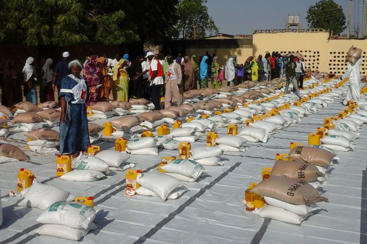 Madinatu Mosque, Maiduguri, Nigeria, 24 January 2015. ICRC staff prepare emergency food supplies for some 3,600 displaced people who fled from Baga to Maiduguri after Boku Haram attacked their town.