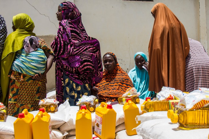 Women queue to collect food and other essentials in Maiduguri, Nigeria.