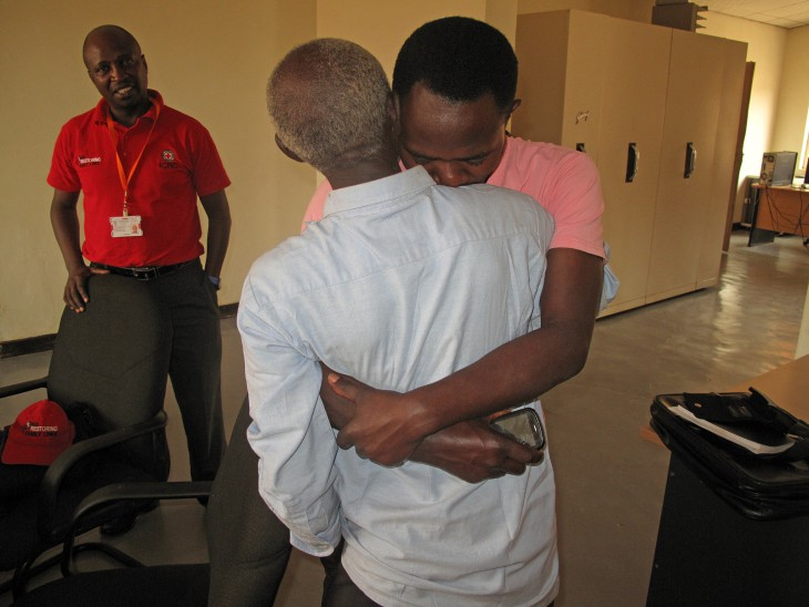 Raymond Ngendahimana embraces the father he has not seen for 22 years, after tracing him through the ICRC.