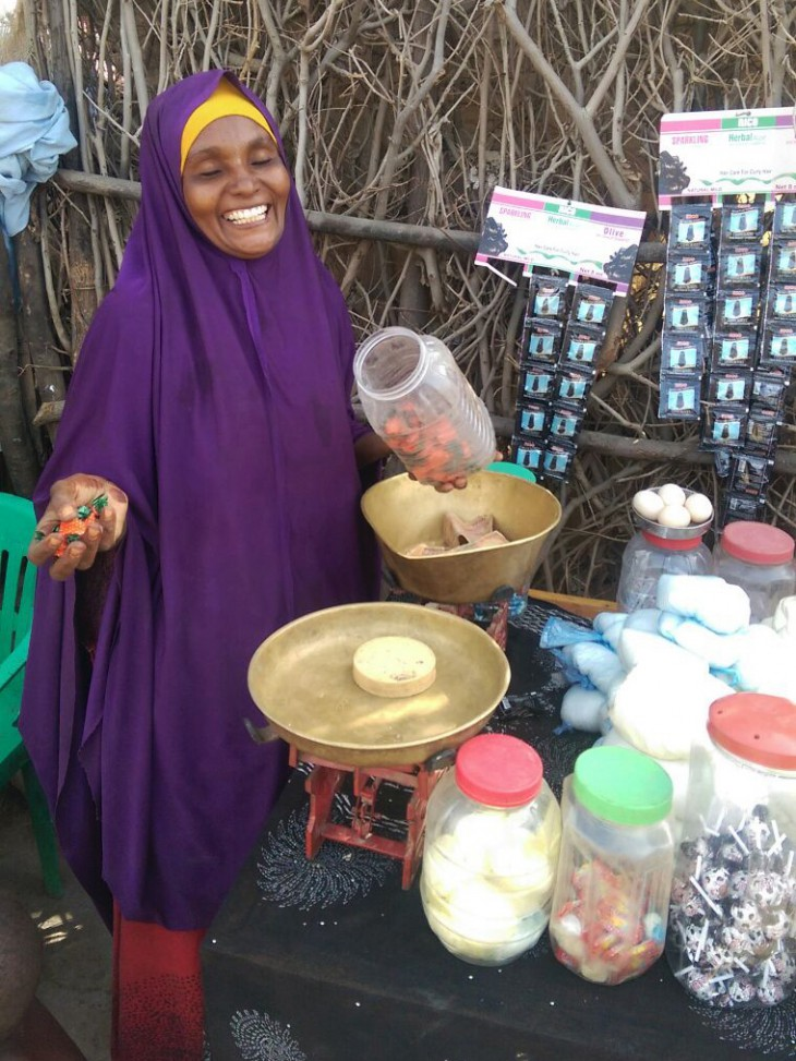International Women's Day. Beletweyne town, Somalia, 2016. Fatuma laughs as she shares a light moment with one of her customers. CC BY-NC-ND/ICRC/Miraj Mohamud