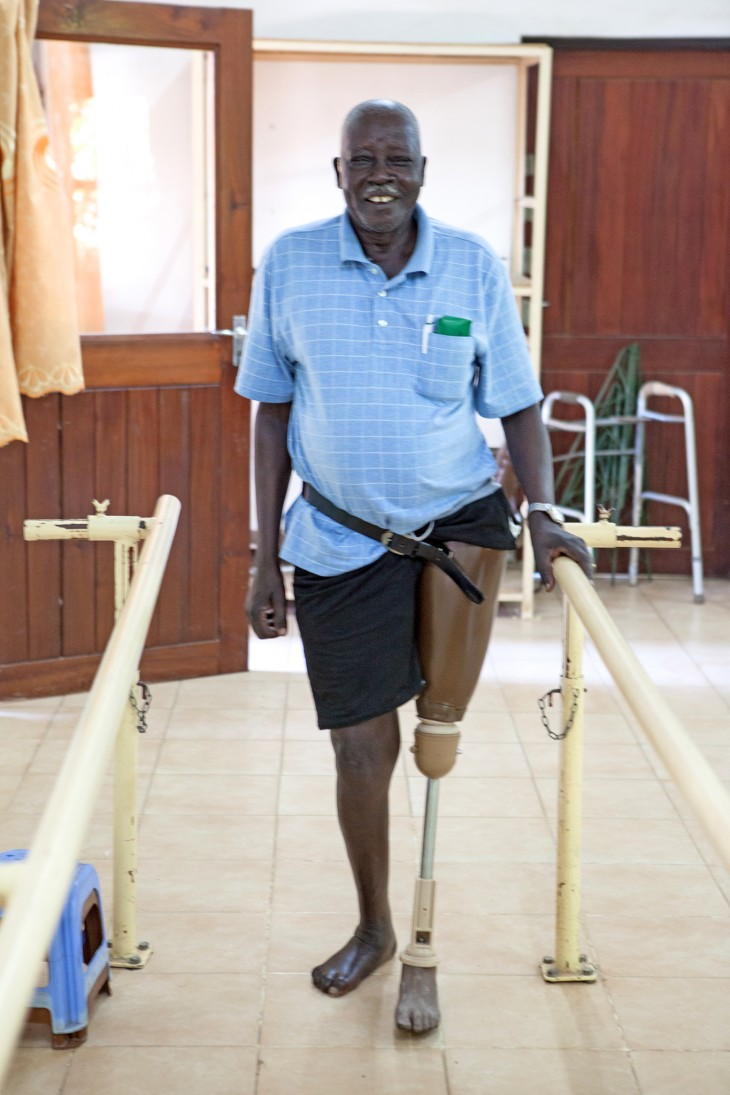 A beaming Nelson Nyumbe shows off the prosthetic leg that has restored his independence.