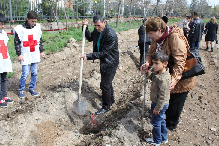Armavir, Armenia. Karine Zaderyan plants a tree with her son and her grandson. Avetis is named after his missing grandfather.