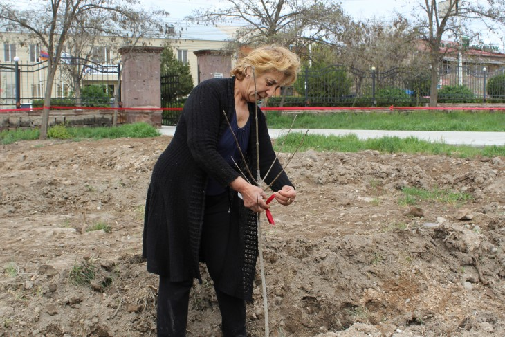 Geghetsik Manukyan has lived alone ever since her son went missing and her husband died. She marks her newly planted tree with a ribbon in a promise to come back regularly to take good care of it.