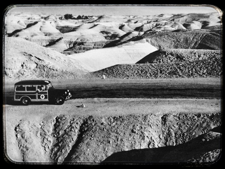 "Palestine, 1950. An ICRC vehicle on the road between Jerusalem and Jericho. One of the photos in the exhibition ""War from the victims' perspective."""