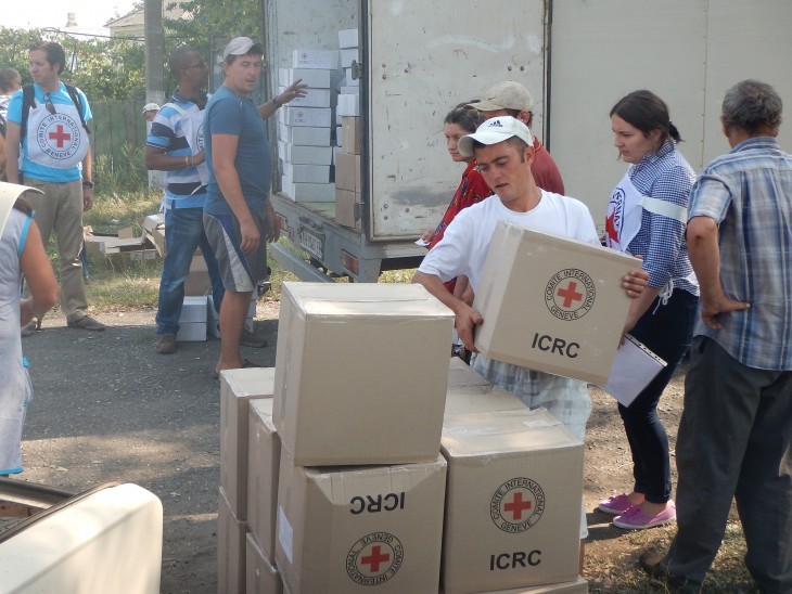 ICRC staff distribute food and other essentials to the people of the village.