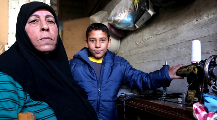 Syria crisis, Winter. Nadia and her grandson Yazan iving in an unfinished building in Kessweh, rural Damascus.