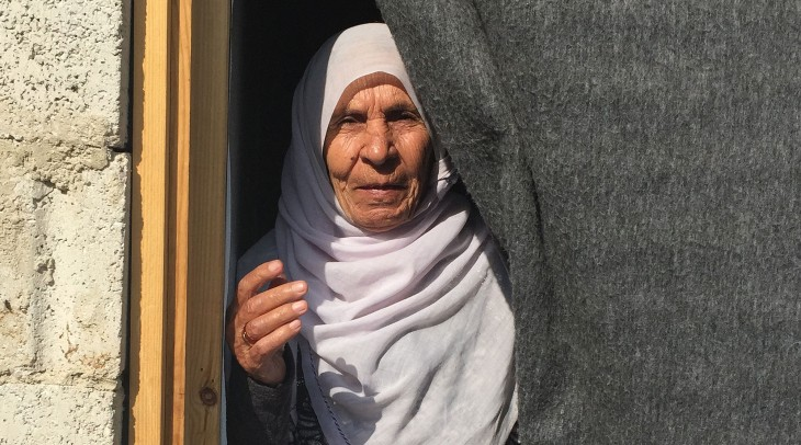 Syria crisis, Winter. Om Arabi,displaced from Darayya in 2012 and now living in a refugee centre in Kessweh, rural Damascus.