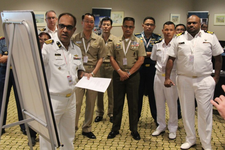 A participant presents his work to officers from several of the region's navies during the workshop, which covered not only naval warfare but also anti-piracy operations, rescue and the movement of people at sea.
