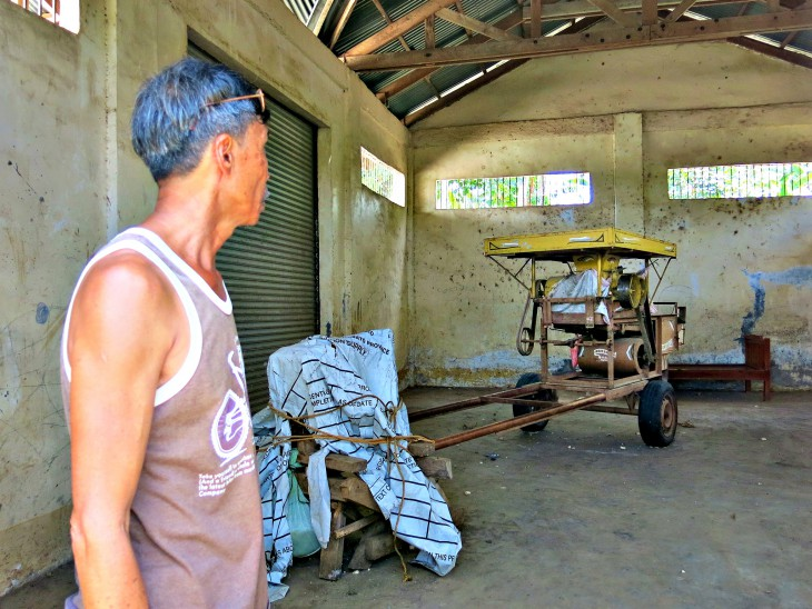 The community corn thresher, sitting idele in the village storehouse