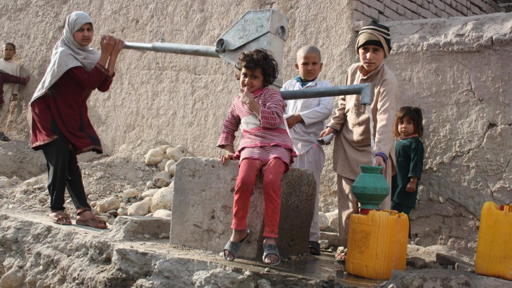 Children fill their jerrycans at a pump repaired by the ICRC.