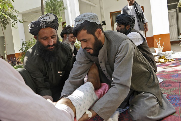 Kandahar, Afghanistan, 29 August 2016. Sakhi Dad, (left) practices the use of basic materials to stop bleeding before transporting a patient to hospital.