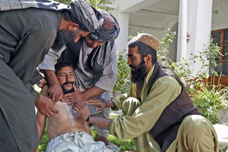 Kandahar, Afghanistan, 29 August 2016. Abdul Wali (right) practices giving first aid to a man with a chest wound.