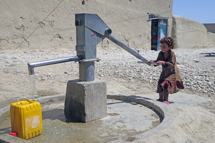 Raaziqa (6) draws water from a borehole in her village.
