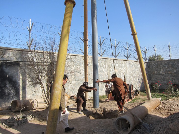 Farah Provincial Prison, Farah Province, Afghanistan. Workers sink a borehole for the new water supply system.
