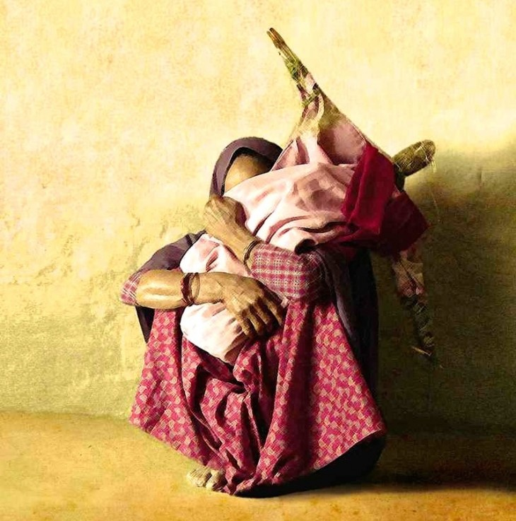 Bhojali Chaudhari tightly holds a doll that represents her missing daughter. As per tradition, the doll is made of sacred grass and is dressed in her daughter's clothes